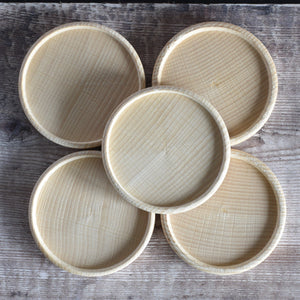 Five wooden coasters