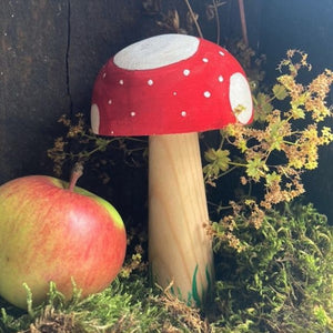 Painted giant wooden mushroom decoration