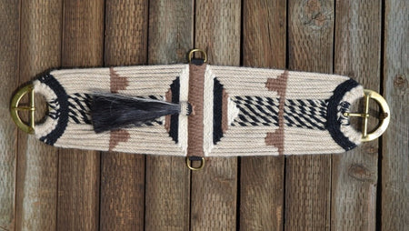 Jose Ortiz Vaquero Brand 27 strand mohair cinch in natural mohair with black and white candy stripe details with black and tan accents.  Brass hardware and 12 inch shu-fly tassel.