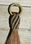"close up jose ortiz vaquero brand 12"" chestnut sorrel horse mane hair shu-fly tassel with hitched horse hair knot in black brown and natural brass ring"