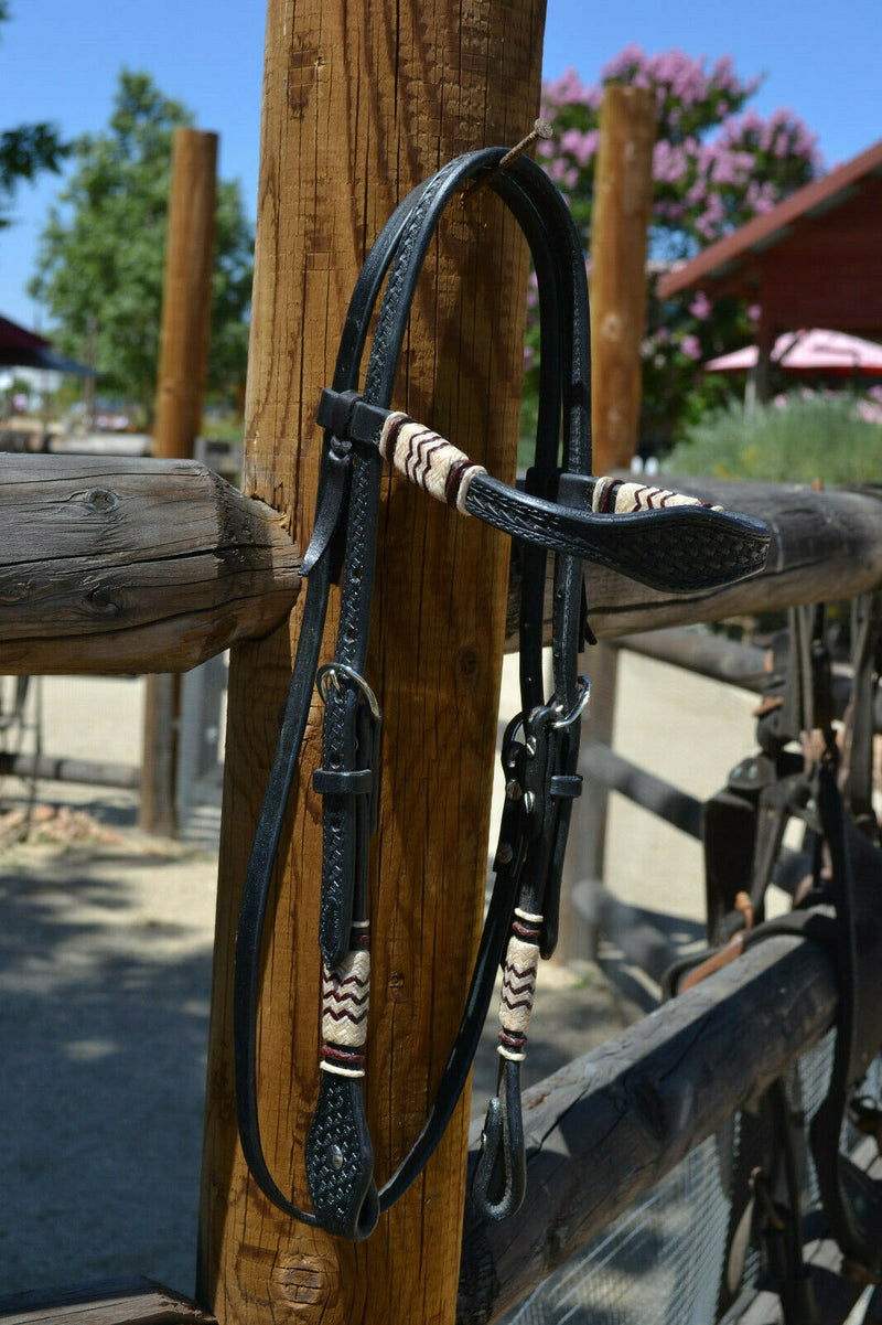 "Jose Ortiz 5/8"" Shape Browband Headstall.  Constructed of two-ply and stitched black finished leather.  Hand carved with Jose's signature basket weave tooling and natural hand braided rawhide with latigo details on cheek pieces and browband."