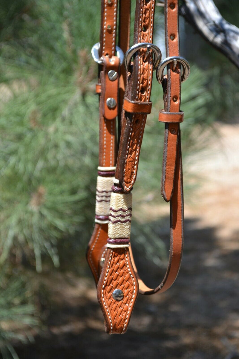 "Close Up View Jose Ortiz 5/8"" Straight Browband Headstall.  Constructed of two-ply and stitched russet oil  finished leather.  Hand carved with Jose's signature basket weave tooling and natural hand braided rawhide with latigo brown details on cheek pieces and browband."