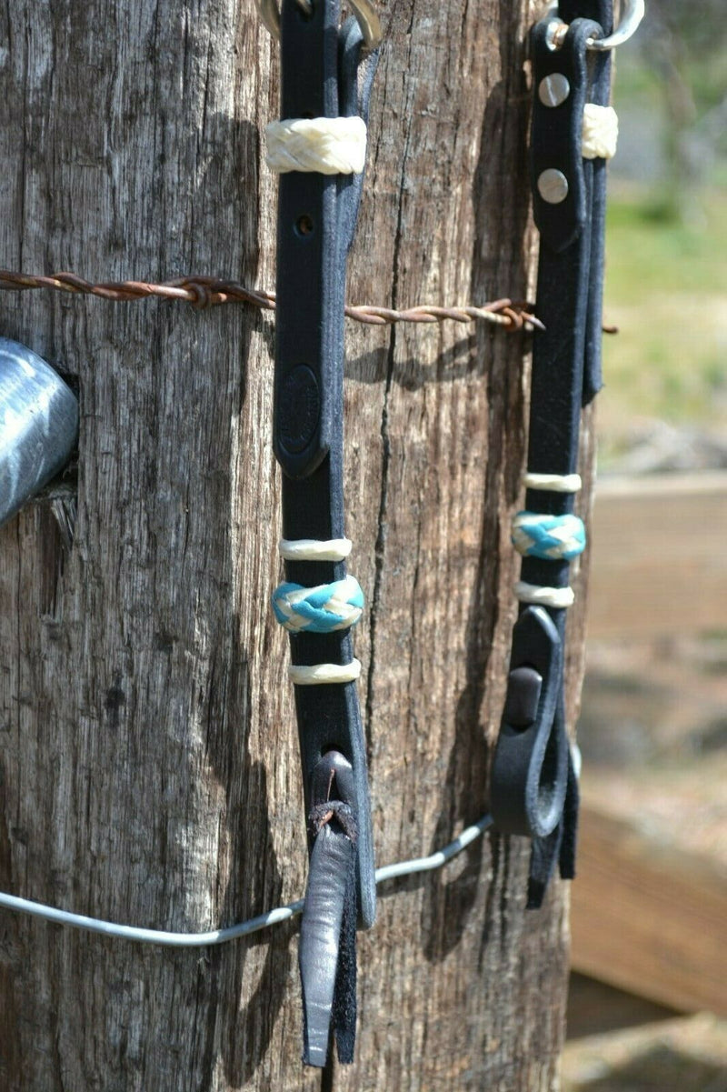"Close Up View Jose Ortiz 5/8"" One/Single Sliding Ear Headstall.  Constructed of single-ply black harness leather.  Hand braided natural rawhide with turquoise details on cheeks and ear piece."