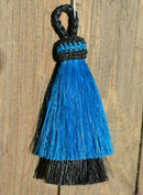 "Close Up View 3"" two Bell mule tail cut natural and brightly colored tassels. Handmade from horsehair dyed in bright colors as well as natural.    Turquoise/Black"