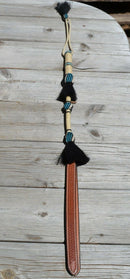 Beautiful Jose Ortiz  Braided Rawhide Quirt Whip with Hitched Horsehair Knots and Hand Tooled Leather Popper.   Natural colored rawhide with turquoise blue and black details.