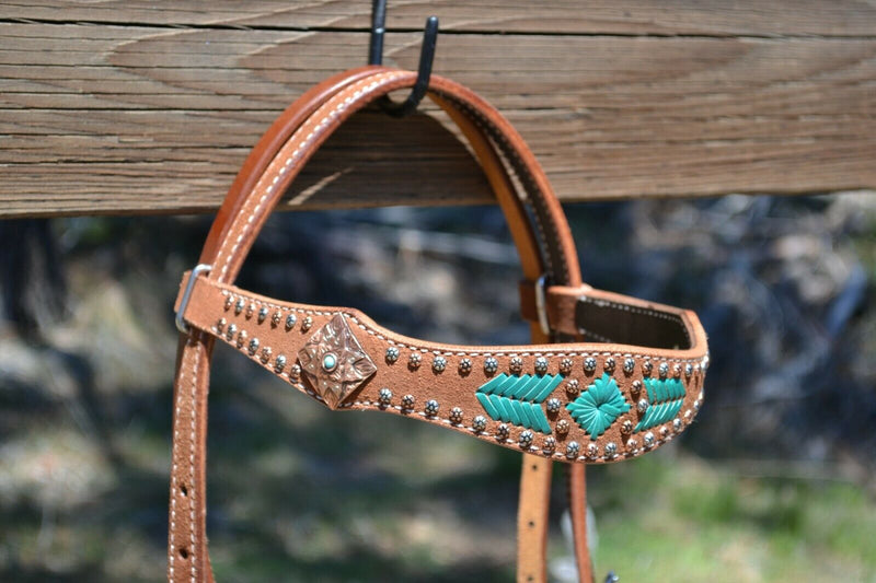"Close Up Front View Reinsman by Circle Y of Yoakum - Molly Powell 2"" Rough Out Leather Browband Headstall with Turquoise Rawhide Lacing and Copper Conchos and alternating antiqued and copper spots."