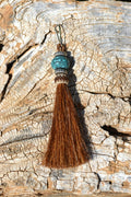 "Close Up View 4 1/2"" total length horsehair zipper pull with spring clip. Handmade horsehair various colors and beading pattern. Sorrel-Silver/RTQ/Silver"