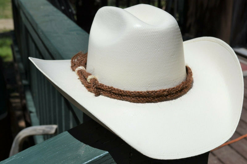 Beautiful Jose Ortiz Traditional Double Strand Hand Twisted Horsehair Hatband with Rawhide Knots.  Made from 2 strands of chestnut twisted horsehair.