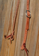 "Close Up Detail Jose Ortiz 3/4"" One/Single Split Ear Headstall.  Constructed of single-ply natural harness leather with natural rawhide buck stitching.   Removable stainless steel buckle and latigo ties the bit ends."