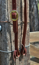 "Close Up View Jose Ortiz 1"" One Single Split Ear Headstall.  Constructed of single ply Burgundy Latigo Leather.    Removable brass buckle and latigo ties at the bit ends."