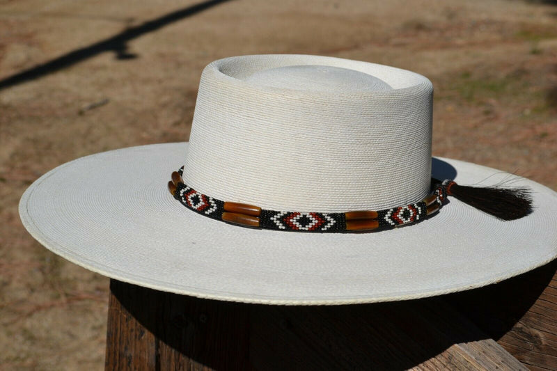 "Beautiful 1/2"" Hand Made Beaded Hatband with Long Bone Beads.  Made from 7 strands of black, brown and white beads and 1"" wide amber color bone beads."