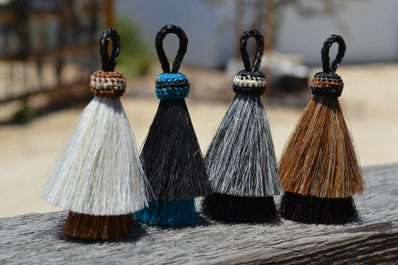 "Close Up View Various Colors 3"" two Bell mule tail cut natural and brightly colored tassels. Handmade from horsehair dyed in bright colors as well as natural."