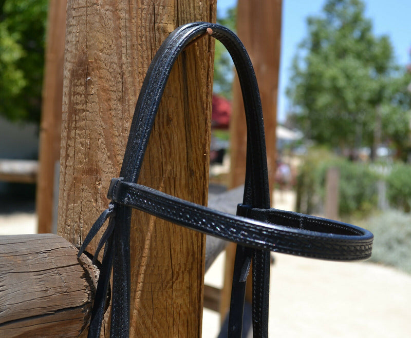 "Close Up Browband View Jose Ortiz 5/8"" Straight Browband Headstall.  Constructed of two-ply and stitched black finished leather.  Hand carved with Jose's signature basket weave tooling."