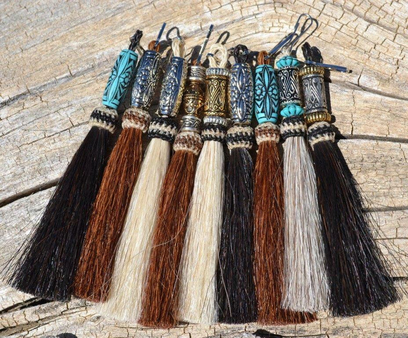 "Close Up View Various Colors 4 1/2"" total length natural horsehair zipper pull with spring clip.  Handmade from 100% natural mane horsehair various colors and beading pattern."