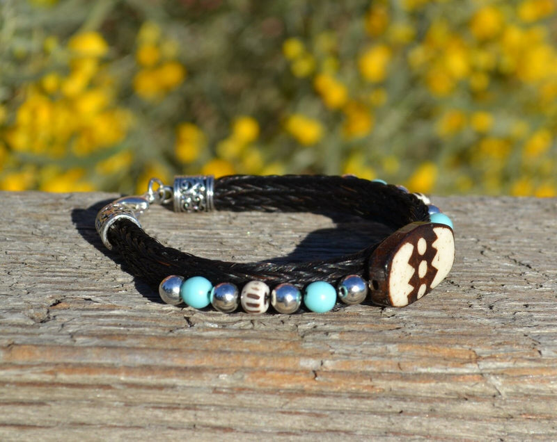 "Close Up View Awesome 3/8"" wide, 3 Strand Braided Horsehair Bracelet with a lobster claw clasp and various colored and patterned bone beads. Black/Turquoise"