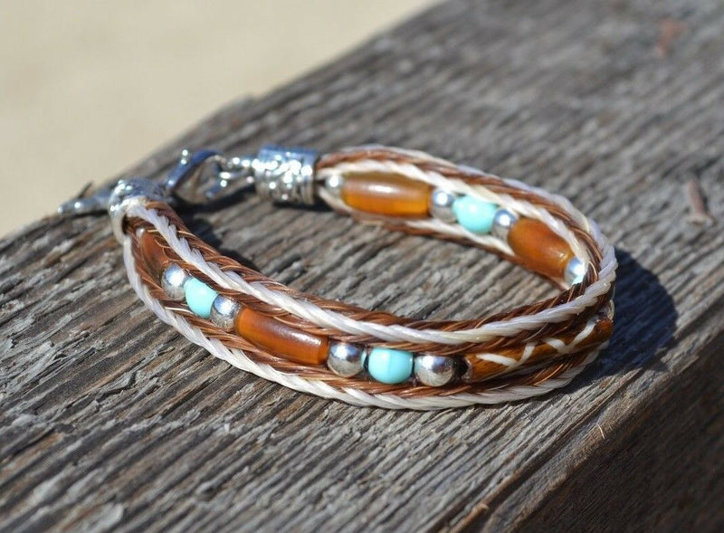 "Close Up View Awesome 3/8"" wide, 3 Strand Braided Horsehair Bracelet with a lobster claw clasp and various colored and patterned bone beads. White/Chestnut/Turquoise"