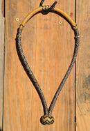 "Jose Oritz 1/4"" 8 plait braided brown beveled rawhide bosal with natural rawhide nose and knot with black details.  Noseband measures 3/8"" wide at the thickest point."