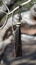 "Close Up View  4 1/2"" total length horsehair zipper pull with spring clip. Handmade  horsehair various colors and beading pattern. Black- Gold/RB/Gold"