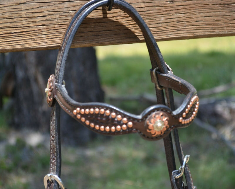 "Close Up Detail View 5/8"" Straight Shaped Browband Headstall  with Antiqued Engraved Copper Buckles and Conchos at bit ends.  Dark chocolate brow bridle leather with removable buckles."