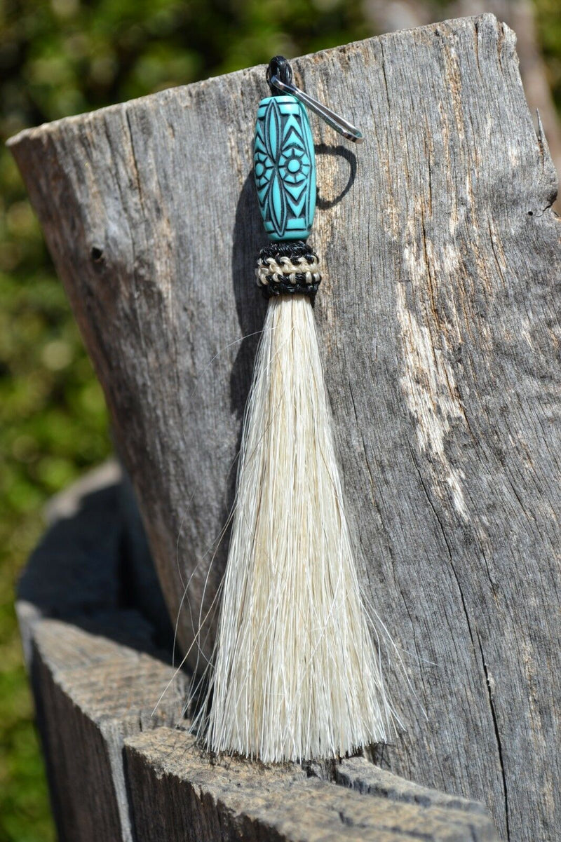 "Close Up View 4 1/2"" total length horsehair zipper pull with spring clip. Handmade horsehair various colors and beading pattern. White-turquoise"