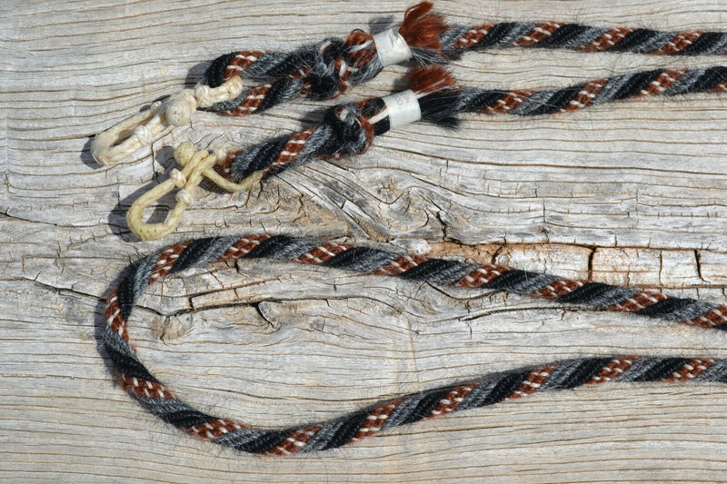 "Close Up View Jose Ortiz handmade angora mohair roping / loop reins - 1/2"", 6 strand, 8 foot long rope made from tightly wound strands of black, grey,  chestnut & white color angora mohair."