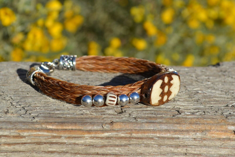"Close Up View Awesome 3/8"" wide, 3 Strand Braided Horsehair Bracelet with a lobster claw clasp and various colored and patterned bone beads. Chestnut/Silver"