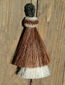 "Close Up View 3"" two Bell mule tail cut natural and brightly colored tassels. Handmade from horsehair dyed in bright colors as well as natural.    Brown/White"