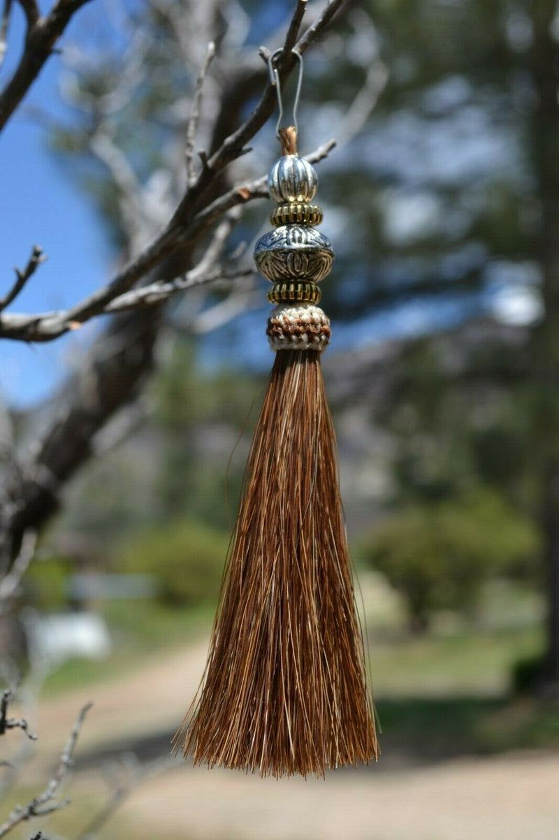 "Close Up View 4 1/2"" total length horsehair zipper pull with spring clip. Handmade horsehair various colors and beading pattern. Sorrel-Gold/RB/Gold"