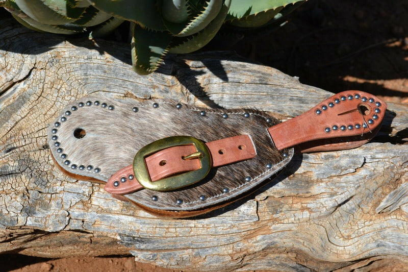 Cowboy Style Hair-On Cowhide Shaped Spur Straps.  Hair-on cowhide with grey & brown brindle coloring with stainless steel spots.  Soft distressed leather lining and Hermann Oak harness leather straps.  Brass buckles.