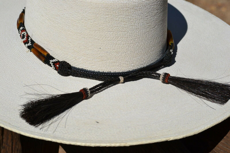 "Close Up Back View Horsehair Tassels Beautiful 1/2"" Hand Made Beaded Hatband with Long Bone Beads.  Made from 7 strands of black, brown and white beads and 1"" wide amber color bone beads."