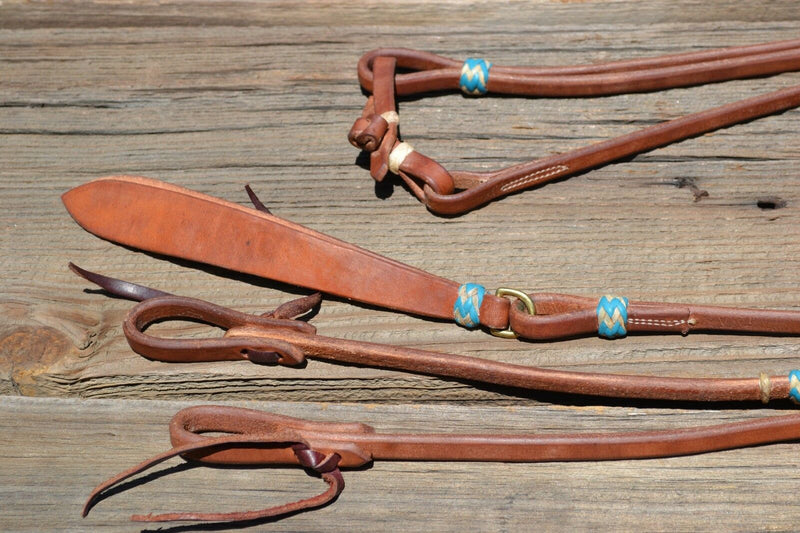 "Detailed View Jose Ortiz 1/2"" Hermann Oak Harness Leather Romel Reins with Hand Braided Natural Rawhide Buttons with Turquoise Details.  Leather is preconditioned  with hand rubbed edges and ready to ride."