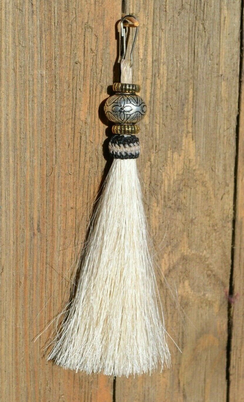 "Close Up View 4 1/2"" total length horsehair zipper pull with spring clip. Handmade horsehair various colors and beading pattern. White-Gold/RBS/Gold"