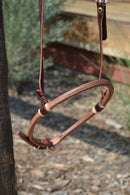 Close Up View Jose Ortiz has made these beautiful rolled harness leather adjustable western training cavesons with latigo hangers.   Made from beautifully conditioned Hermann Oak harness leather and natural rawhide hanger knots.  Stainless buckle