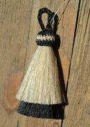 "Close Up View 3"" two Bell mule tail cut natural and brightly colored tassels. Handmade from horsehair dyed in bright colors as well as natural.     White/Black"