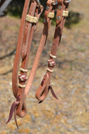 "Close Up View Jose Ortiz 5/8"" Shape Browband Headstall with Natural Hand Braided Rawhide Buttons with Brown details.  Constructed of single-ply Hermann Oak conditioned harness leather with hand rubbed edges."