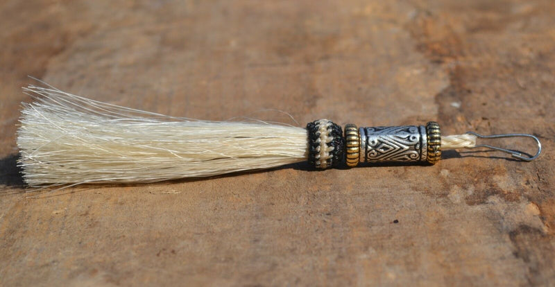 "Close Up View 4 1/2"" total length horsehair zipper pull with spring clip. Handmade horsehair various colors and beading pattern. White-Gold/Silver/Gold"
