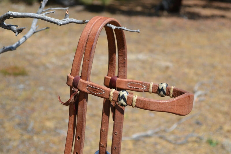 "Close Up View Handmade browbnd Headstall Jose Ortiz 5/8"" Shape Browband Headstall with Natural Hand Braided Rawhide Buttons with black details.  Constructed of single-ply Hermann Oak conditioned harness leather with hand rubbed edges."