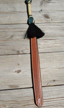 Close Up View Beautiful Jose Ortiz Braided Rawhide Quirt Whip with Hitched Horsehair Knots and Hand Tooled Leather Popper. Natural colored rawhide with turquoise blue and black details.