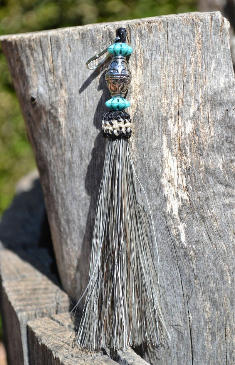 "Close Up View 4 1/2"" total length horsehair zipper pull with spring clip. Handmade horsehair various colors and beading pattern. Grey-Turquoise/Silver/Turquoise"
