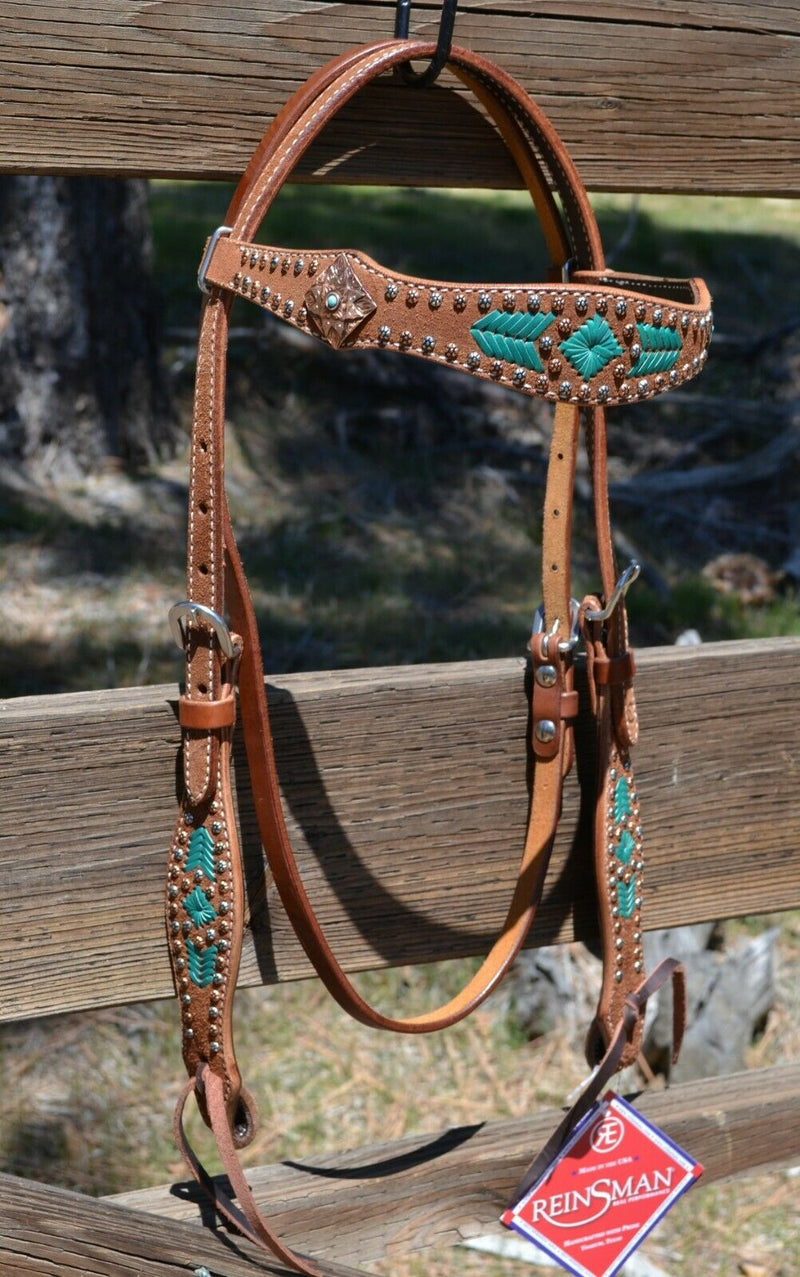 "Front View Reinsman by Circle Y of Yoakum - Molly Powell 2"" Rough Out Leather Browband Headstall with Turquoise Rawhide Lacing and Copper Conchos and alternating antiqued and copper spots."