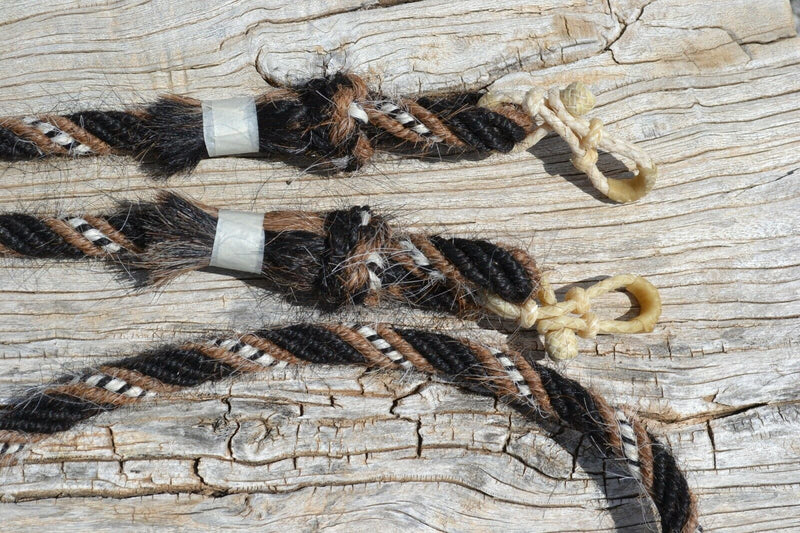 "Close Up View Jose Ortiz handmade roping/loop reins - 5/8"", 6 strand, 8.5 foot length roping loop reins made from a combination of 6 tightly wound strands of black, sorrel (light chestnut), white & black natural mane hair."