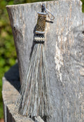 "Close Up View 4 1/2"" total length horsehair zipper pull with spring clip. Handmade horsehair various colors and beading pattern. Grey-Silver/Gold/Silver"