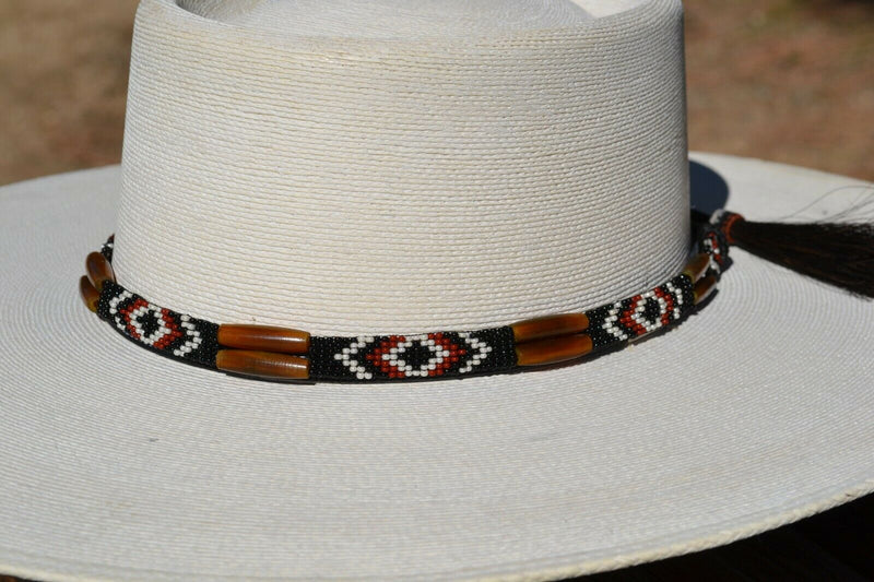 "Close Up View Beautiful 1/2"" Hand Made Beaded Hatband with Long Bone Beads.  Made from 7 strands of black, brown and white beads and 1"" wide amber color bone beads."