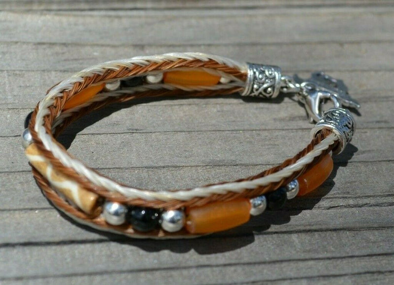 "Close Up View Awesome 3/8"" wide, 3 Strand Braided Horsehair Bracelet with a lobster claw clasp and various colored and patterned bone beads. White/Chestnut"
