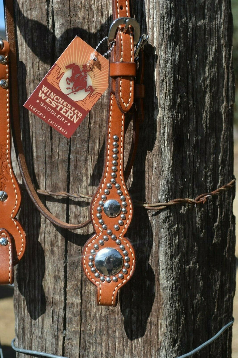 Close Up View Detail Billy Cook Shape/Scalloped Browband Cowboy Headstall with Conchos and Spots. Made from chestnut colored leather, two-ply and stitched with wheat color stitchting.