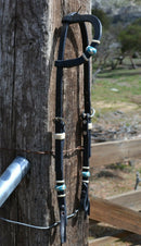 "Jose Ortiz 5/8"" One/Single Sliding Ear Headstall.  Constructed of single-ply black harness leather.  Hand braided natural rawhide with turquoise details on cheeks and ear piece."