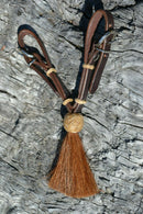 "Jose Ortiz handmade 1/2"" dark chocolate leather curb strap with tightly braided natural rawhide knot and chestnut mane horsehair tassel."
