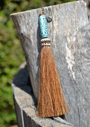 "Close Up View 4 1/2"" total length horsehair zipper pull with spring clip. Handmade horsehair various colors and beading pattern. Sorrel-Turquoise"