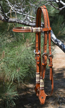 "Jose Ortiz 5/8"" Straight Browband Headstall.  Constructed of two-ply and stitched russet oil  finished leather.  Hand carved with Jose's signature basket weave tooling and natural hand braided rawhide with latigo brown details on cheek pieces and browband."