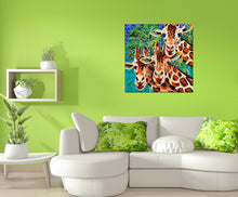 Load image into Gallery viewer, Three Giraffe friends painting in a living room